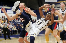 Kent State's redshirt junior guard Megan Carter falls the the floor during a battle for a rebound during the game against Duquense University.