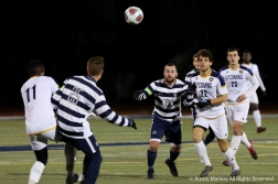 Lycoming University and Penn State Behrend players all battle for the ball during the first round of the NCAA Division tournament at John Carroll Univeristy on Saturday, Nov. 10, 2018.