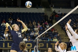 Navy's senior middle blocker Katie Patrick attempts a kill during the first round of the NCAA tournament against the University of Michigan on Friday. Nov. 30, 2018. This was Navy's first appearance in the national tournament in program history but they lost in straight sets in the first round.