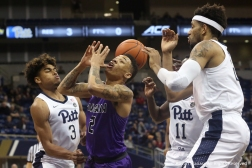 Niagara University's sophomore guard Keleaf Tate has the ball stolen from him while he drives to the basket in the game at the University of Pittsburgh on Monday, Dec. 3, 2018.