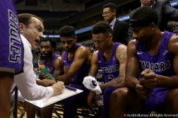 Niagara University's head coach Chris Casey talks to his team during a time out in the game at the University of Pittsburgh on Monday, Dec. 3, 2018. The Purple Eagles won 71-70 in a huge upset over the Panthers.