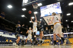 University of Akron's freshman forward Colleen Neitzel and Northern Kentucky University's freshman forward Emmy Souder battle for a rebound during the second women's game of the Kent State Classic hosted by Kent State University on Nov. 18, 2018.