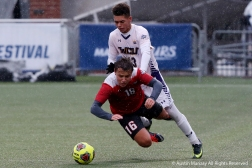 Barry University's sophomore midfielder Toby Fura falls while battling with West Chester Univeristy's junior midfielder Brett Miller during the NCAA Division 2 Championship game in Pittsburgh, Pennsylvania on Saturday, Dec. 1, 2018.