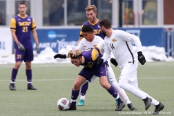 West Chester University's senior midfielder Andrew Slater battles with two players from Cal Poly Ponoma during the NCAA Division 2 Semi Final game in Pittsburgh Pennsylvania on Thursday Nov. 29, 2018.