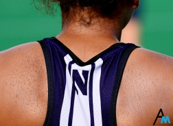 Sweat beads on the back a Northwestern field hockey player's during their win against Kent State University. Temperatures reached into the 90s with the heat index pushing 100 degrees.