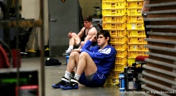 Wrestlers lean against crates and react to losing bouts at the national championships in Cleveland, Ohio.