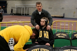 University of Iowa's head coach Terry Bands helps reigning national champion Spencer Lee loosen up before his first bout of the season at Kent State University on Friday, Nov. 9, 2018.