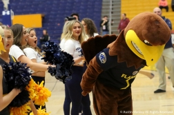 Kent State University's cheerleaders react as the mascot shows his backside before the start of a basketball game on Jan. 8, 2019. Flash and the cheerleaders get along very well and never fail to bring a smile to the faces of kids in the crowd.