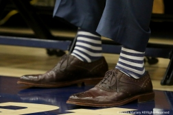 Kent State University's Head Women's Basketball Coach Todd Starky shows off his colorful socks before the start of a game on Jan. 5, 2019.
