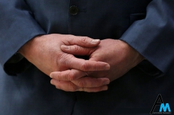 Kent State University's head women's basketball coach, Todd Starkey, folds his hands during a game.
