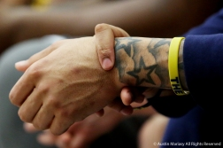 Kent State'e Junior Center sits on the bench holding onto his tattooed wrist.