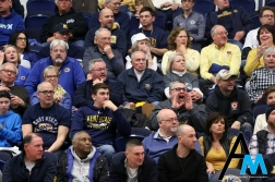 Fans watch and become angry at the referees during a game between Kent State University and Eastern Michigan University on Feb. 16, 2019. The crowd became very angry at the referees after a flagrant foul was called on Kent State's Phillip Whittington. Security was called to the scorer's table because they were afraid fans would get violent toward the refs standing there reviewing a call.