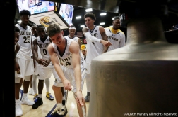 The Kent State University Men's Basketball team celebrates behind freshman guard Sam Norton as he rings the victory bell after the team's first home win on Nov. 13, 2018. Norton got his first minute of play in the Flashes' home opener against Shawnee State University. This was the first time he rang the victory bell.