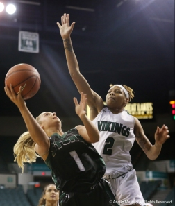 Lake Erie College's freshman guard Elain Billing attempts to shoot on Cleveland State's freshman forward Savanna Crockett during the game at Cleveland State on Nov. 16, 2018.