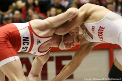 North Carolina State University's graduate student Justin Oliver wrestles with Ohio State's redshirt senior Micah Jordan during their bout at Ohio State on Sunday, Jan. 6, 2019.