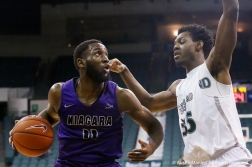 Niagara University's senior forward Marvin Prochet drives to the basket against Cleveland State's freshman Deante Johnson during the game at Cleveland State on Dec. 19, 2018.