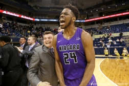 Niagara University's redshirt senior forward Greg King celebrates after the team upset the University of Pittsburgh 71-70 in Pittsburgh. This victory was Pittsburgh's second loss on the season and it snapped a 3-game losing streak by the Purple Eagles.