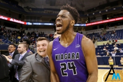 Niagara University's redshirt senior forward Greg King celebrates after the team upset the University of Pittsburgh 71-70 in Pittsburgh. This victory was Pittsburgh's second loss on the season and it snapped a three-game losing streak by the Purple Eagles.