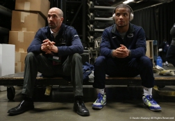 Penn State University's Mark Hall sits with his coach Casey Cunningham before his championship bout against Arizona State's Zahid Valencia. Hall lost the bout and earned a second place finish.