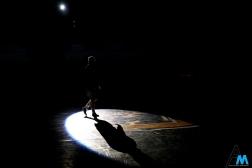 A University at Buffalo wrestler walks across the mat before a dual at Kent State University on Jan. 26, 2018.