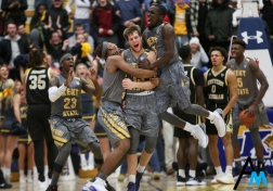 Kent State's sophomore guard Mitch Peterson celebrates with teammates after scoring the go-ahead basket with .3 seconds left on the clock against Western Michigan on Jan. 16, 2018.