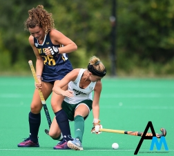 Kent State University's junior back Clara Rodriguez Seto and Ohio University's sophomore midfielder Emma Spinetto trip over each other during an exhibition game.