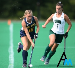 Kent State University's freshman back Meghan Daly drives passed Ohio University's sophomore midfielder Emma Spinetto during an exhibition game at Kent State University.