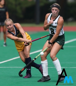 Kent State junior forward Laila Richter steals the ball from Michigan State junior forward Maggie Cole.