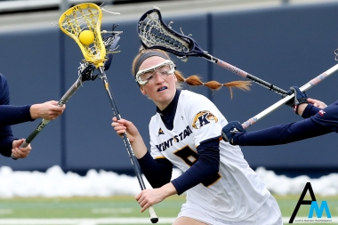 Kent State University's freshman midfielder Eva Nikolai attempts to pass the ball while being surrounded by Robert Morris players during Kent's first ever home lacrosse game.