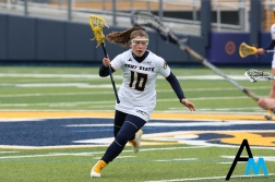 Kent State University's freshman midfielder Madison Rapier drives the ball down field against Robert Morris on Feb. 16, 2019. The Flashes lost their first ever home game 11-6 to the Colonials.