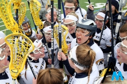 Kent State University's freshman LLuna Katz gets the team ready to play their first ever home game on Feb. 16, 2019. Kent State announced the addition of the 19th varsity team in June 2016.