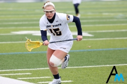 Kent State University's freshman attach Megan Kozar runs down the field during Kent State's first ever home game second game in history. Kent State announced the team in 2016 and they played their first game in Cincinnati on Feb. 10.