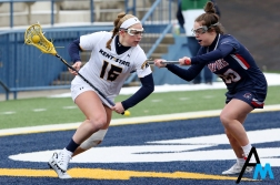 Kent State University's freshman attach Megan Kozar drives passed Robert Morris' junior defense Madison Burke during the Flashes first ever home game on Feb, 16, 2019.