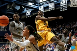 Kent State University's junior forward Danny Pippen tries to recover a rebound against the University of Akron on March 2, 2018. Kent and Akron are rivals and participate in the annual Battle of the Wagon Wheel across all sports.