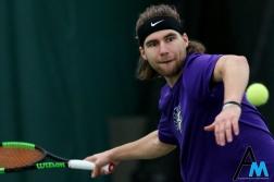 Niagara Univeristy's senior Lukas Wenninger prepares to hit the ball during a match against Edinboro on Feb. 10, 2019.