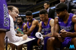 Niagara University's head coach Chris Casey talks to his team during a time out in the second half of the game at the University of Pittsburgh on Dec. 3, 2018. Niagara upset Pittsburgh 70-71 to snap a three game losing streak.