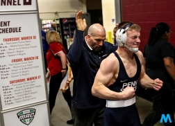 Penn State's assistant coach Casey Cunningham helps Jason Nolf loosen up before his championship bout against North Carolina State's Hayden Hidlay in the NCAA Wrestling Tournament in Cleveland, Ohio. Nolf defeated Hidlay and took first in the nation for the 157 weight class. Penn State took the team championship as well as 4 of 10 individual championships.