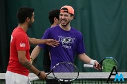 Niagara University's senior Bruno Goncalves laughs with Edinboro's senior Mateus Santos after Edinboro defeated Niagara in the doubles set.