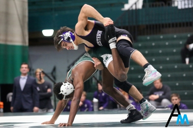 Northwestern's #1 Sebastian Rivera drives Michigan State's #6 Rayvon Foley to the mat during their bout at Michigan State on Feb. 8, 2019. Rivera won the bout in a 13-3 major decision to remain undefeated on the season.