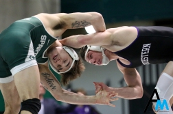 Northwestern's #3 Ryan Deakin wrestles with Michigan State's Jake Tucker during their bout at Michigan State on Feb. 9, 2019. Deakin defeated Tucker in a 7-3 decision.