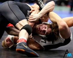 Ohio State's Joey McKenna, in black, and Lehigh's Luke Karam spar during a qualifying round of the NCAA Wrestling Championships. McKenna won and went on to defeat Bucknell's Tyler Smith in the quarterfinals and lost to Wyoming's Bryce Meredith in the semifinal round to place third in the nation.