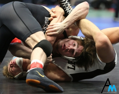Ohio State's Joey McKenna and Lehigh's Luke Karam spar during a qualifying round of the NCAA Wrestling Championships. McKenna won and went on to defeat Bucknell's Tyler smith in the quarterfinals and lost to Wyoming's Bryce Meredith in the semifinal round. Mckenna placed third in the nation after defeating Missouri's Jaydin Eierman.