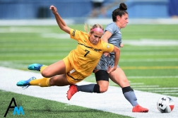Kent State University's junior defender Yasmine Hall falls while battling for the ball with St. Bonaventure's freshman midfielder Emily Foltz. Kent State won the game 2-1 to finish off a three-game home stand to start the season.