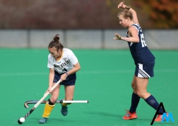 Kent State senior midfielder Jessica Nesbitt accidently rips the stick out of the hands of Longwood junior forward Leonie Verstraete during the MAC semifinal game in Kent, Ohio on Friday, Nov. 3 2017. Kent State won the game but lost to Miami in the final.