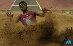 Bloomsburg University's junior Dave Lauscar hits the sand after a long jump at Youngstown State University on Feb. 2, 2018. Youngstown State hosts a regional open every season and it usually falls in late January or early February.