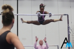 Kent State University head coach Brice Biggin prepares to catch junior Jade Brown should she fall off the uneven bars during a meet against the Western Michigan University Broncos on March 1, 2019.