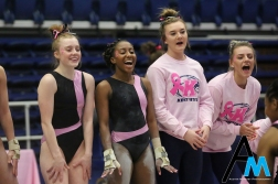 Kent State University gymnasts cheer on one of their own during her floor routine during a meet against Western Michigan University on March. 1, 2019.