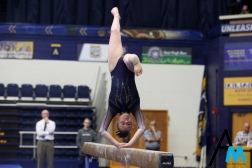 Kent State University's freshman Riley Danielson competes on the beam during a tri meet against North Carolina State and George Washington University on Feb. 24, 2019.