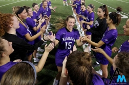 Niagara University's junior defender Lauren Paul runs through the tunnel of hands during team introductions before the game at Ohio State on March 3, 2019. The Purple eagles lost 16-12 but had a stellar 8-3 second half.