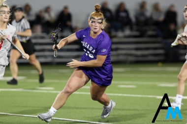 Niagara University's senior attack Caroline Crump drives to the goal against Ohio State on March 3, 2019. Caroline scored the Purple Eagle's first goal of the game in the 6th minute. The Purple Eagles lost 16-12 following a stellar comeback attempt and going 8-3 in the second half.